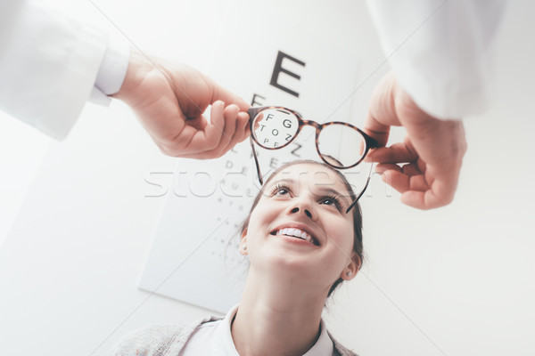 Felice donna nuovo occhiali giovani coppia Foto d'archivio © stokkete