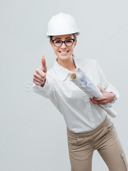 Cheerful female architect Stock photo © stokkete