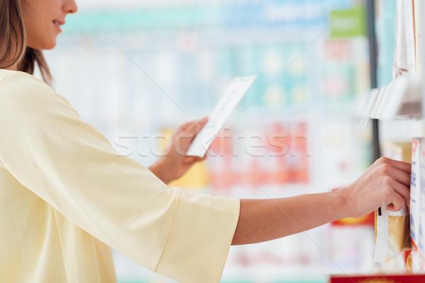 Woman reading a shopping list Stock photo © stokkete