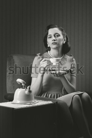Woman cooling herself with fan Stock photo © stokkete
