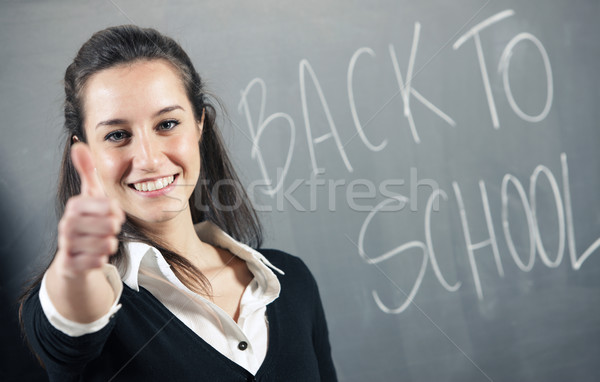 back to school: portrait of a young student gesturing thumbs-up  Stock photo © stokkete
