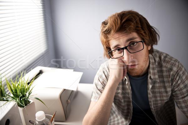 Vervelend baan jonge vervelen vent kantoor Stockfoto © stokkete