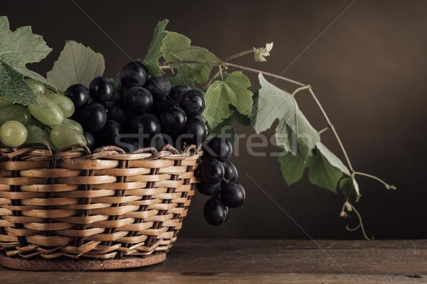 Ripe grapes in a basket still life Stock photo © stokkete