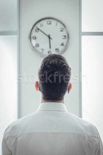 Businessman staring at the clock Stock photo © stokkete