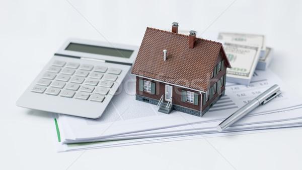 Onroerend woningkrediet model huis calculator cash Stockfoto © stokkete