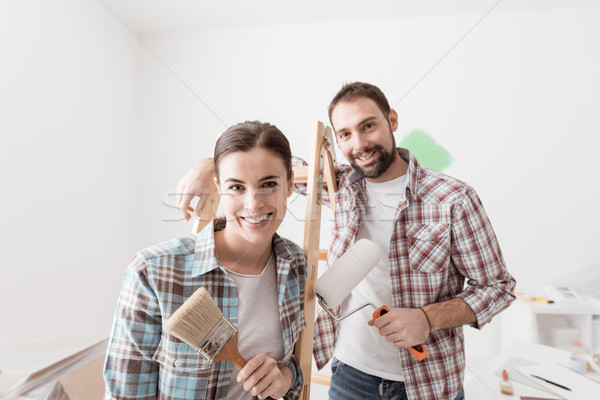 Creative couple renovating their house Stock photo © stokkete