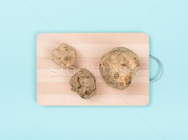 Sweet potatoes on a chopping board Stock photo © stokkete