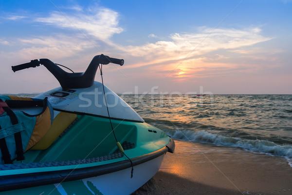 Jet ski plage ciel bleu coucher du soleil nature paysage Photo stock © stoonn