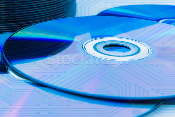 Closeup compact discs (CD/DVD) with the circuit board Stock photo © stoonn