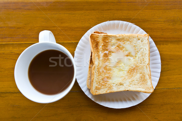 Foto stock: Xícara · de · café · leite · brinde · mesa · de · madeira · café