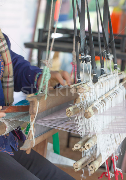 Woman weaving white pattern on loom Stock photo © stoonn