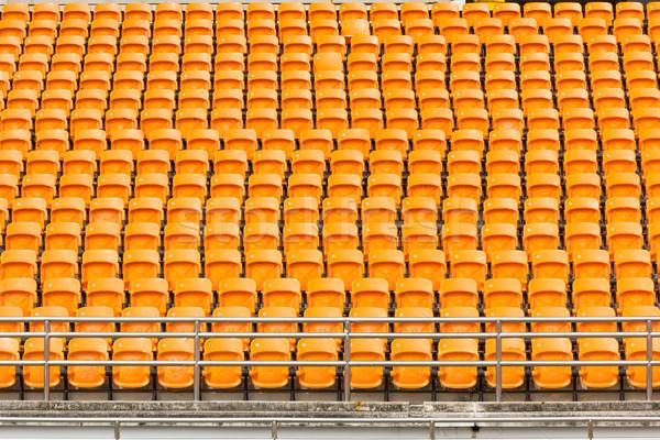 Rows of empty plastic stadium seats Stock photo © stoonn