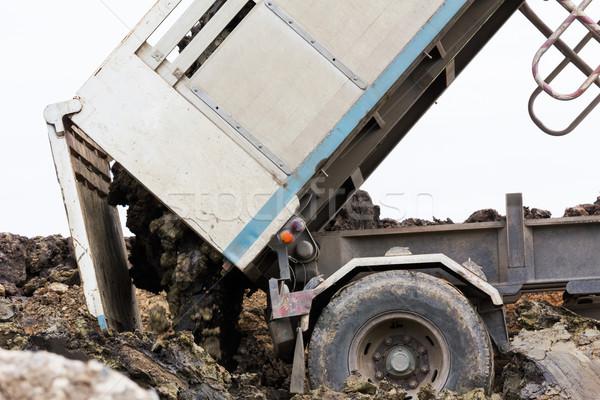 Dump truck dumping Stock photo © stoonn