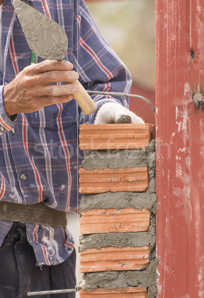 Bricklayer working in construction site of  brick wall Stock photo © stoonn