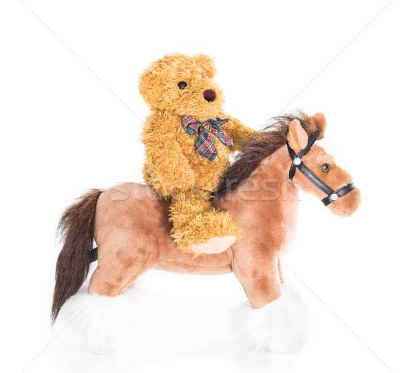 Teddy bear riding a horse Stock photo © stoonn