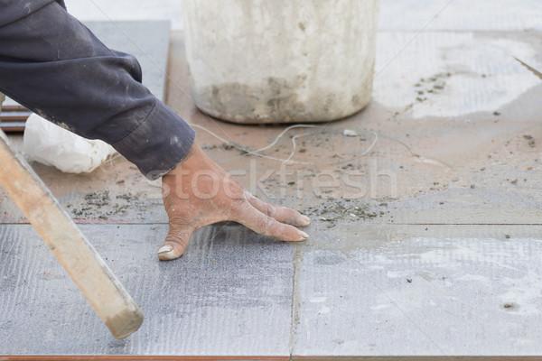 Mason tiling on floor Stock photo © stoonn