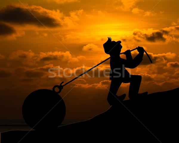 Man with pulling a heavy load ball silhouette Stock photo © stoonn