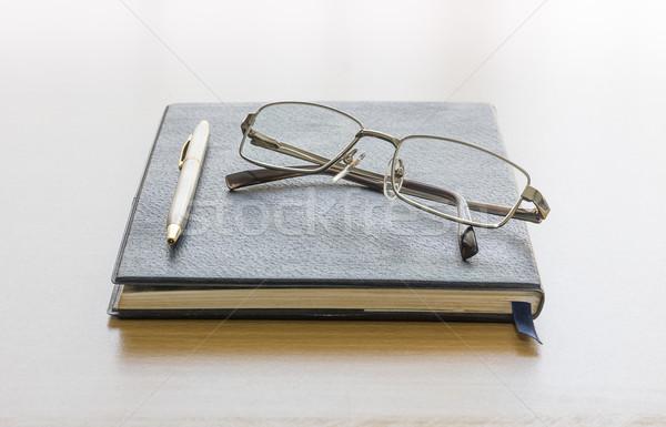 Black book with glasses Stock photo © stoonn