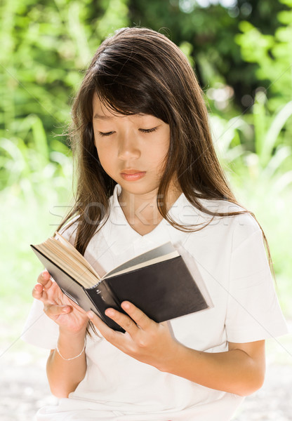 Asian girl reading book Stock photo © stoonn