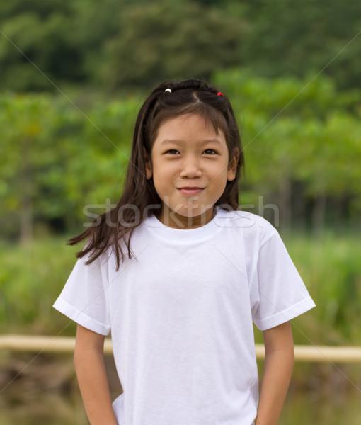 Retrato asiático jovem ao ar livre belo árvore Foto stock © stoonn