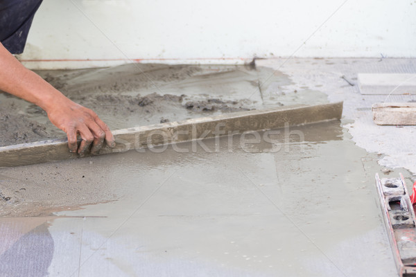 Builder worker plastering concrete at floor Stock photo © stoonn