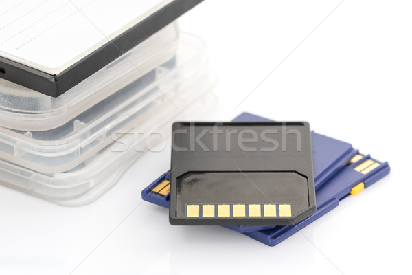 SD memory card and case on white background Stock photo © stoonn