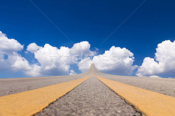 Road asphalt to the sky over the clouds Stock photo © stoonn