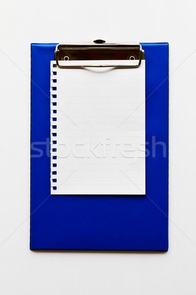 Blank notepaper on a  blue clipboard Stock photo © stoonn