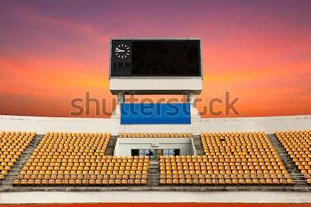 Wazig stadion scorebord klok boven hemel Stockfoto © stoonn