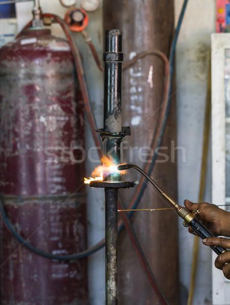 Javít vág rázkódás tűz munka fény Stock fotó © stoonn