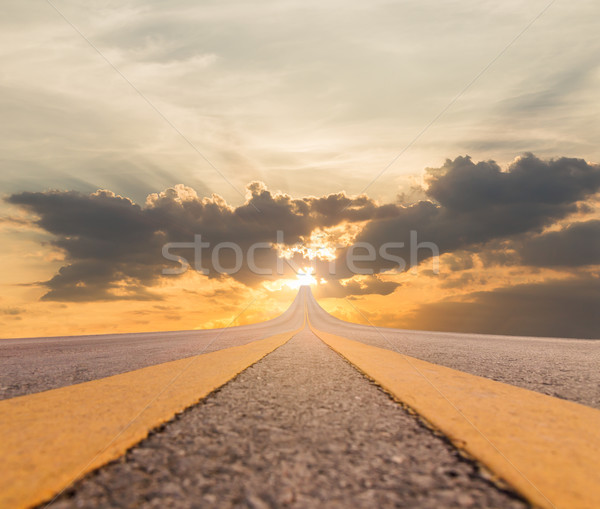 Road asphalt suspended to sunset Stock photo © stoonn