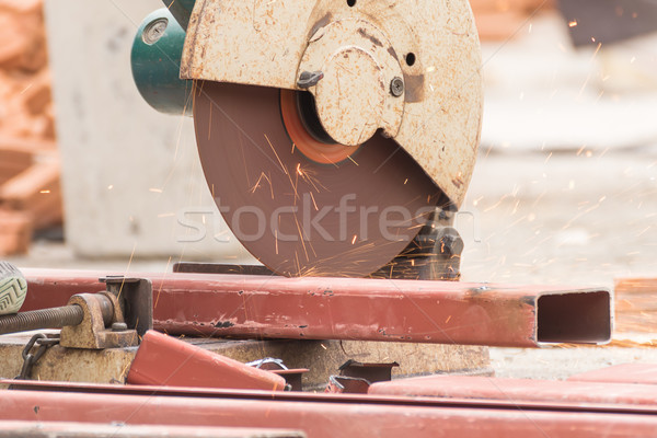 Worker cutting metal with grinder in construction site Stock photo © stoonn