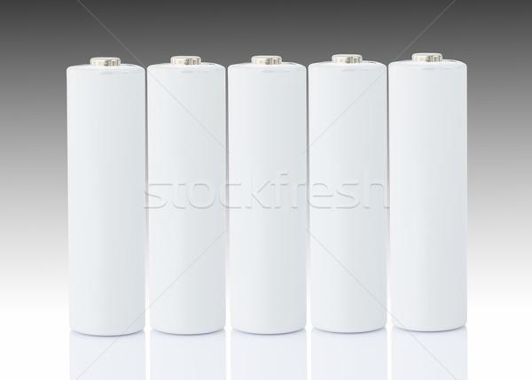 AA batteries over white Stock photo © stoonn