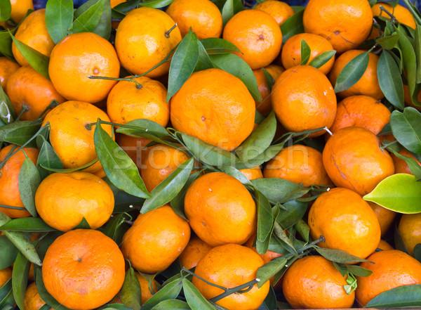 Vers oranje vruchten markt voedsel groene bladeren Stockfoto © stoonn