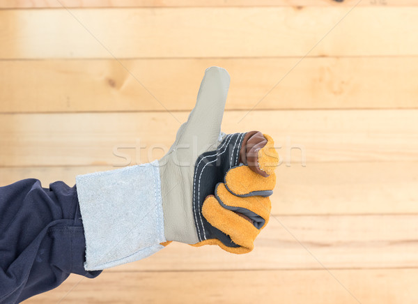Hand in rough leather glove Stock photo © stoonn