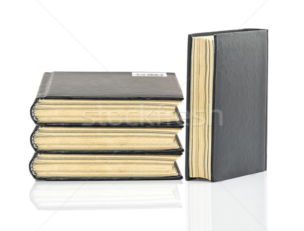 Black hardcover book on white glossy background Stock photo © stoonn
