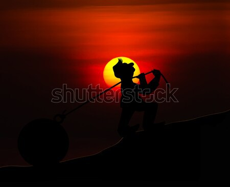 Man with pulling a heavy load ball silhouette with sunset  Stock photo © stoonn