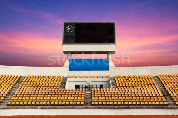 Stadion scorebord oranje klok boven Stockfoto © stoonn