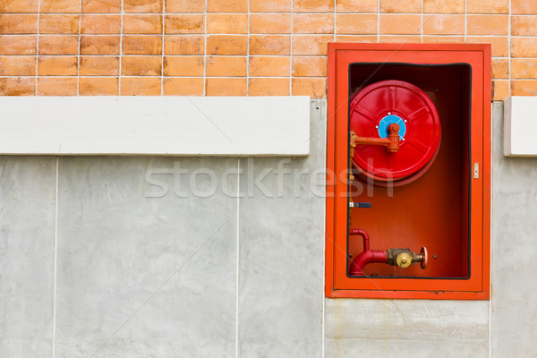 Fire extinguishers on wall Stock photo © stoonn