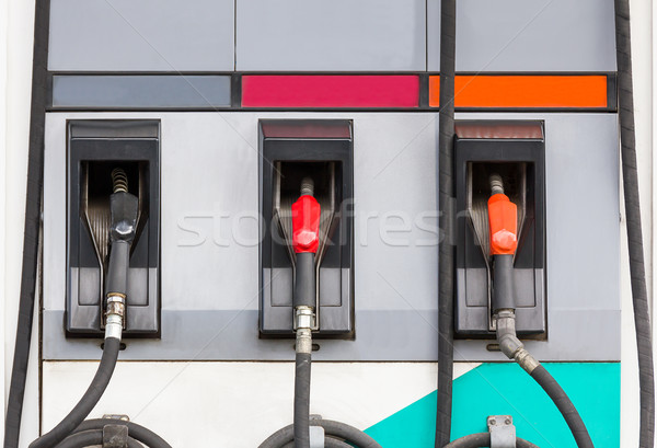 Three refuel nozzles in gas station Stock photo © stoonn