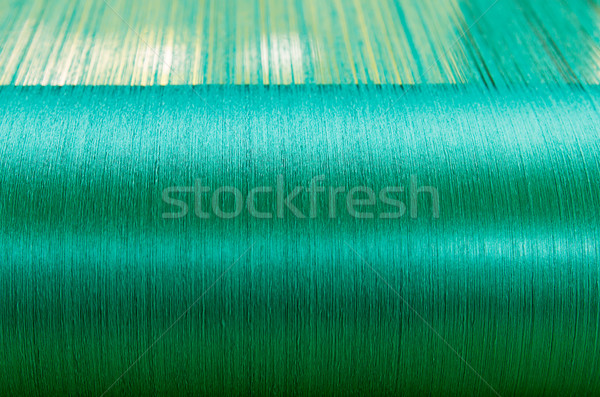 Green silk on a warping loom of a textile mill   Stock photo © stoonn