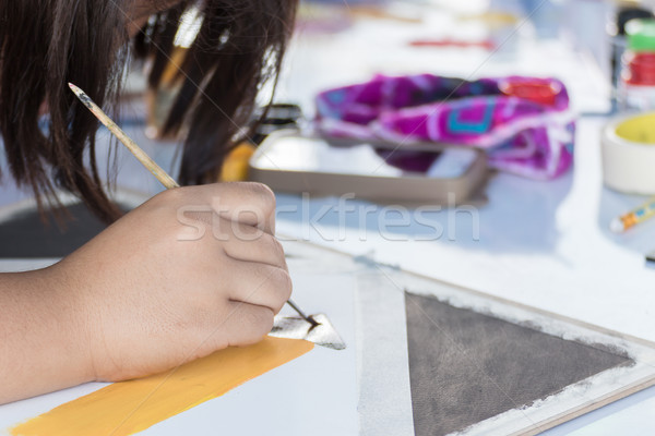 Stock photo: Hand with brush and paint by watercolors