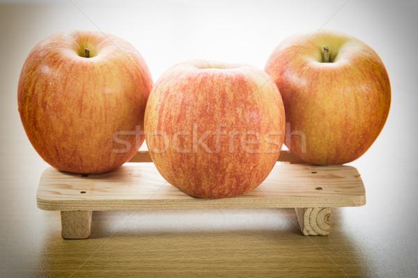 Apple on wood tray Stock photo © stoonn