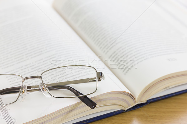 Close up glasses and a book on the desk  Stock photo © stoonn