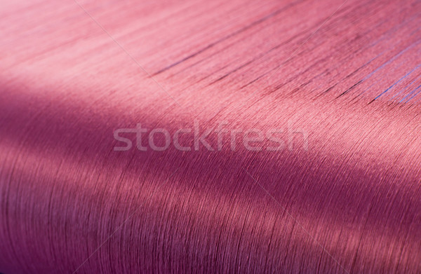 Red silk on a warping loom of a textile mill   Stock photo © stoonn