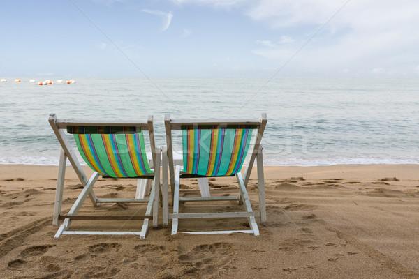 şezlong plaj su sevmek çift yaz Stok fotoğraf © stoonn