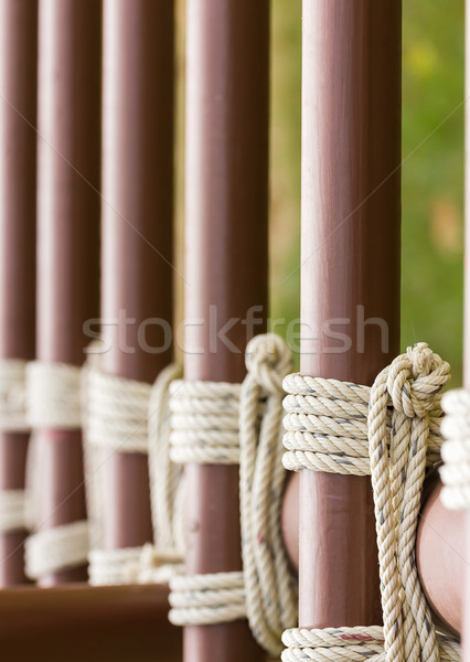 Rope knot around a metal fence  Stock photo © stoonn