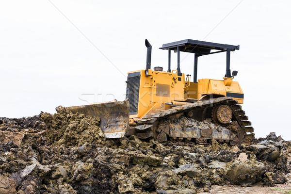 Escavadeira máquina terra em movimento trabalhar Foto stock © stoonn