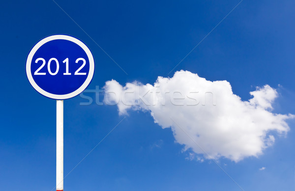 Round sign 2012 on blue sky Stock photo © stoonn