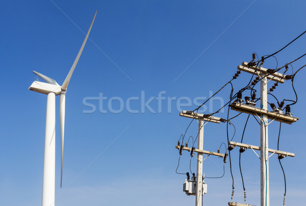 Wind turbine and power lines transporting  Stock photo © stoonn